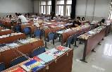 【图】济南大学考研一族疯狂占座:铁丝、砖头