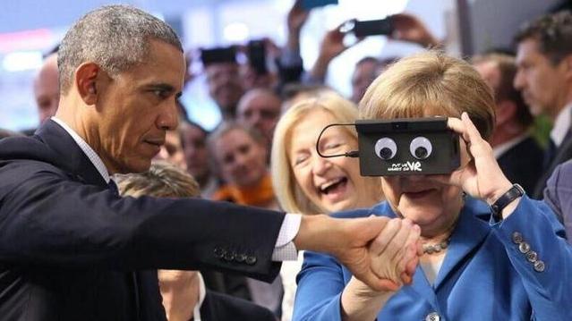 奥巴马和默克尔牵手玩VR 表情萌萌哒