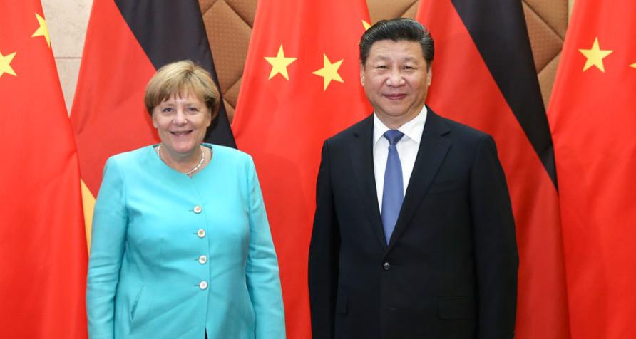 6月13日,国家主席习近平在北京会见德国总理默克尔。
