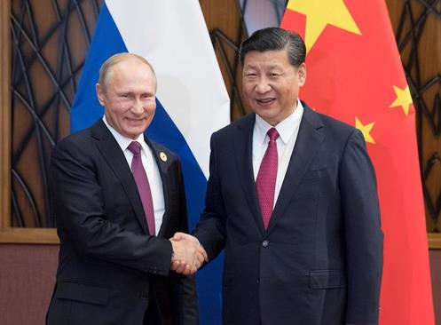2017年11月10日,习近平在越南岘港会见俄罗斯总统普京。图片来源:新华网
