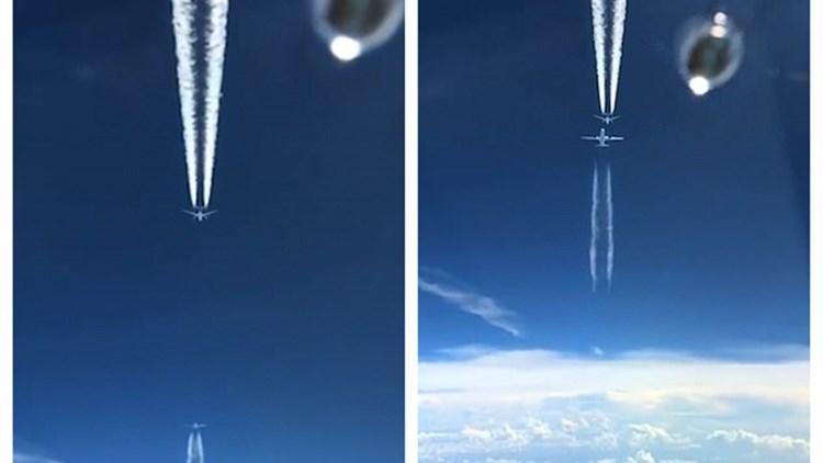奇观!三架客机在一条垂直线上飞 两架看似撞一起