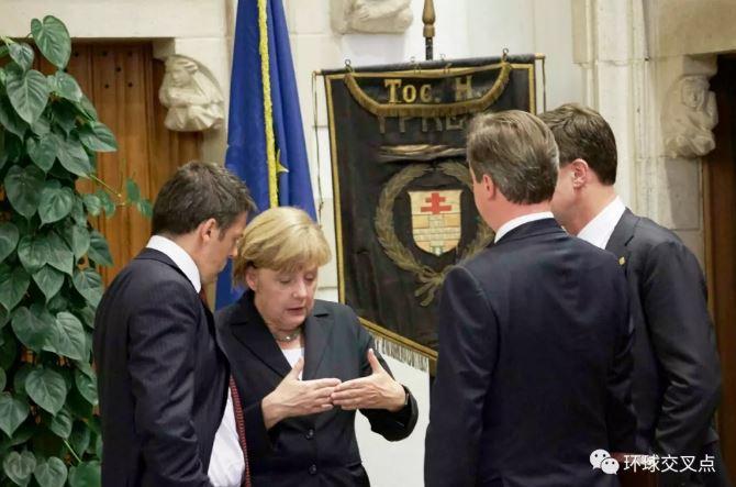 2014年6月默克尔在比利时召开的欧盟峰会上商讨此事