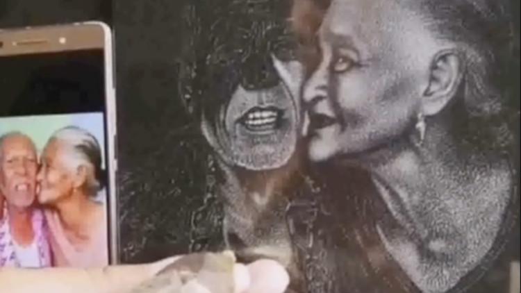 惊艳!大叔在黑色花岗岩上刻画 曾花5年雕上海滩